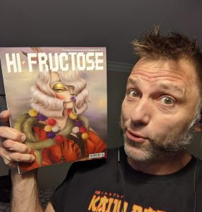 The artist, Tom Sepe, Holding Hi-Fructose magazine