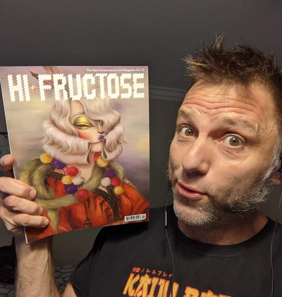 The artist, Tom Sepe, Holding Hi-Fructose magazine